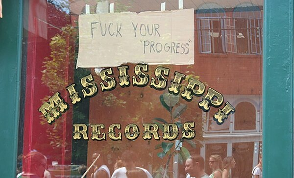 A sign at Mississippi Records' original location during the 2004 Mississippi Street Fair. IMAGE: Courtesy of Eric Isaacson.