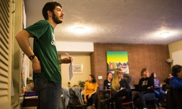 Portland Tenants United organizer Anthony Bencivengo leads a recent meeting to talk about tenant demands at Holgate Manor. (Walker Stockly)