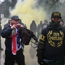 Kyle Brewster, with American flag as scarf, at the state capitol on Jan. 6. (Justin Yau)