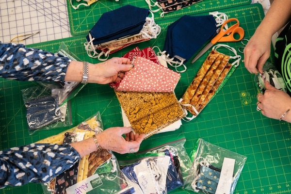 Michele Hetrick teamed up with Carrie Garvey, manager of Montavilla Sewing Company's Gresham store, to distribute fabric masks to Portland-area hospital workers.(Christine Dong)