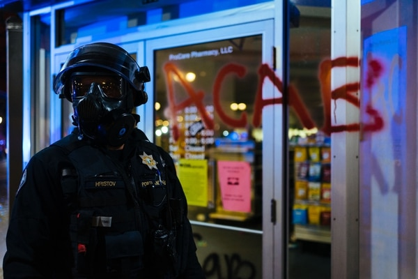 A police officer outside CVS Pharmacy. (Alex Wittwer)