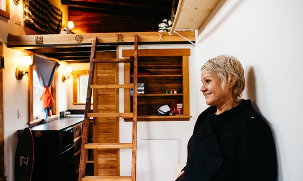 HANDMADE IN PORTLAND: Luz Gomez lives in a tiny home, handcrafted by a Portland artisan, parked in the driveway of a quarter-acre lot in the Cully neighborhood. (Christine Dong)