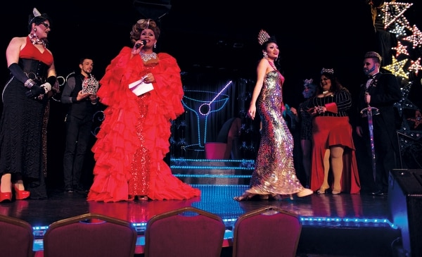 Poison Waters (left) good-naturedly rebukes Lulu Luscious for hogging the spotlight at Darcelle XV. (Thomas Teal)