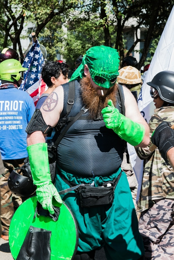 "A Patriot Prayer supporter came to the protest dressed as Pepe the Frog, an icon of fringe groups known as the ""alt-right."" (Justin Katibak)"