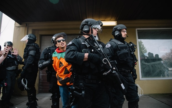 """Luis Enrique Marquez, a 45-year-old comedy writer, has been arrested twice this year in confrontations with right-wing groups, including the April 29 """"free speech"""" march on 82nd Avenue, to which he wore a pumpkin suit. (Joe Riedl)"""