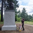 Two visitors admire a bust of York, two days after its base was vandalized. (Aaron Mesh)