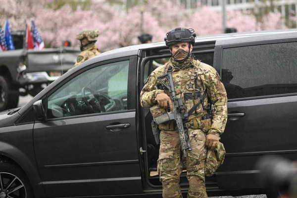 SWAT officer in front of his minivan on March 28. (Justin Yau)