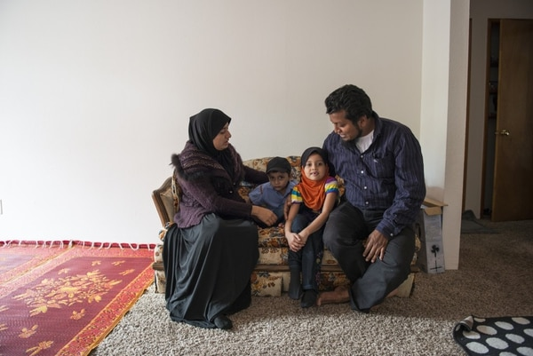 RECENT ARRIVALS: Mohamad Sharif Mohibullah (right) and his family arrived in Oregon in mid-July. (Thomas Teal/WW)