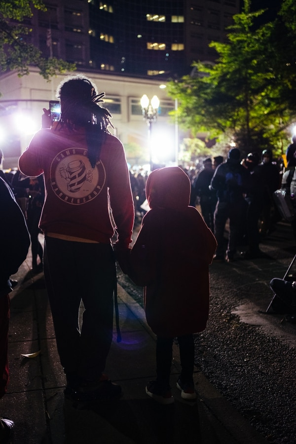 A father and his daughter on the outskirts of the protest that sprawled across Chapman Square, outside the Justice Center.
