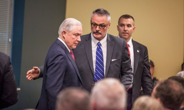 District Attorney for Oregon Billy Williams (center) and U.S. Attorney General Jeff Sessions (left) in Portland last fall. (Sam Gehrke)