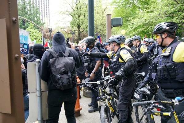 Police and protesters at May Day protest (William Gagan)