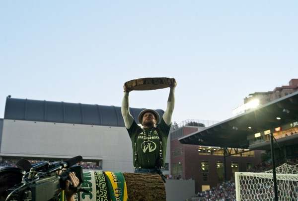 Timber Joey holds up the piece of log he cut, showing the Timbers made a goal. (Jacob Garcia)