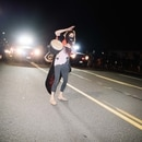 A protester bangs a drum in front of squad cars in Southeast Portland on Sept. 5. (Alex Wittwer)