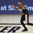 Portland Trail Blazers guard Damian Lillard (0) reacts after making a three point basket against the Dallas Mavericks during the second half of a NBA game at The Field House. IMAGE: Kim Klement-USA TODAY Sports.