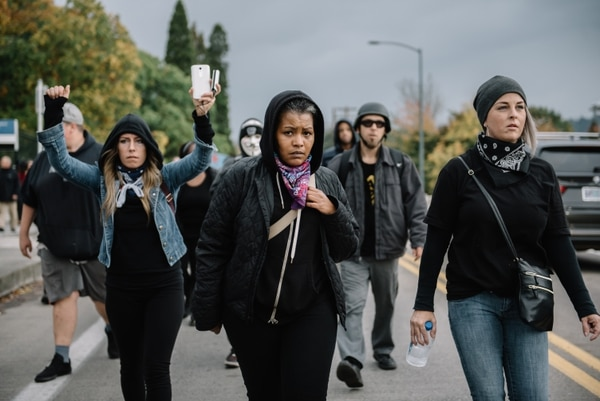 Don't Shoot Portland founder Teressa Raiford (center) marches to Mayor Charlie Hales' house on Oct. 14, 2016. (Joe Riedl)