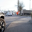 Cars parked to close to a crosswalk can block views of oncoming traffic. (Justin Katigbak)