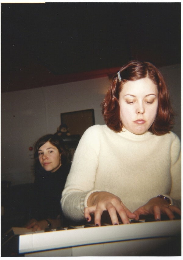 Sleater-Kinney's Carrie Brownstein (background) and Corin Tucker at Jackpot in 1999. IMAGE: Courtesy of Larry Crane.