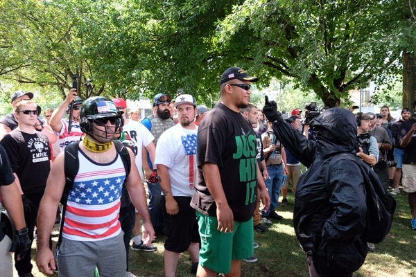 Tusitala Toese is confronted by an antifa protester in Tom McCall Waterfront Park on Aug. 6, 2017. (Daniel Stindt)
