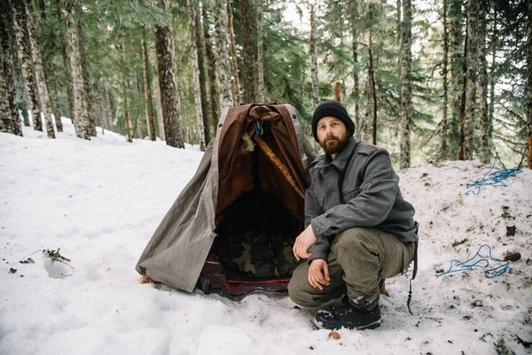 On the south slope of Mount Hood, Valentino shows how to make an improvised tent with a saw, two tarps and some rope. (Joe Riedl)