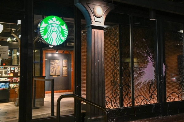 The window of a Starbucks in downtown Portland is splattered with paint on May 1, 2021. (Justin Yau)