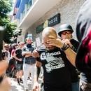 Joey Gibson enters a crowd of antifascist protesters on Aug. 4, 2018. (Justin Katigbak)