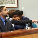 Charles McGee hugs his attorney, Christine Mascal, as Aubre Dickson (left) looks on after the reading of a not-guilty verdict. (Aimee Green / The Oregonian, Oregonlive.com)