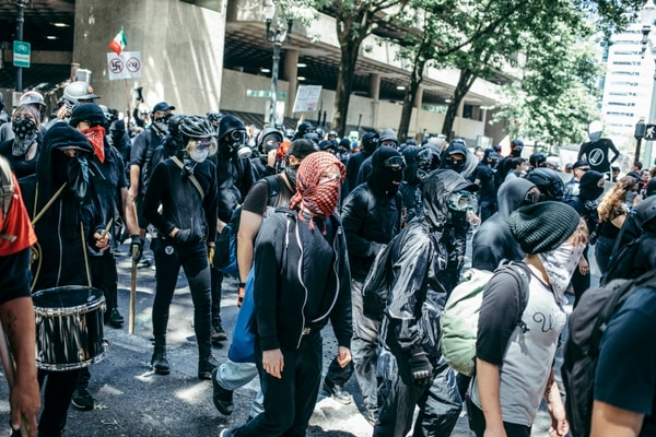 "Antifascists came downtown Aug. 4 clad in head-to-toe ""black bloc"" dress. (Sam Gehrke)"