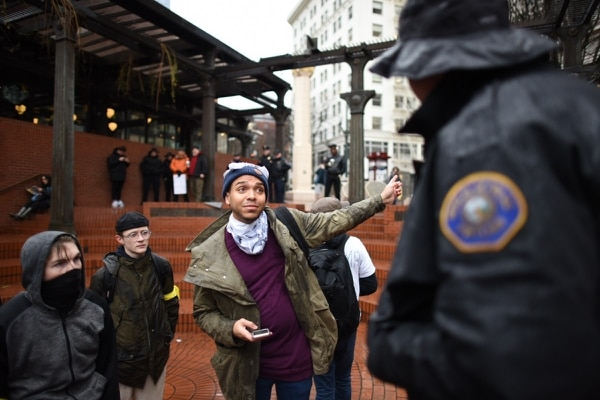 Portland protest organizer Gregory McKelvey negotiates with police officers for use of a megaphone on Jan. 20, 2017. (Joe Riedl)