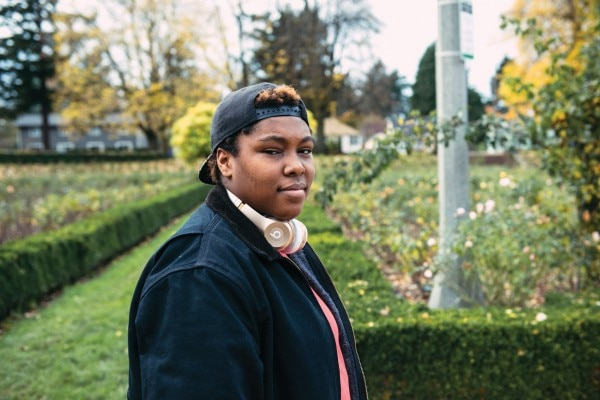 """DEFYING CATEGORIES: Llondyn Elliott, 19, identifies as non-binary. Elliott rejects masculine and feminine pronouns—as well as the label lesbian, calling it too specific. """"We don't limit ourselves to this,"""" Elliott says. (Thomas Teal)"""