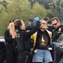 Portland police arrest an environmental protester at Zenith Energy on April 22, 2019. (Allison Place)
