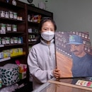 IN MEMORIAM: Jina Yoo, the owner of Cured Green, holds up artwork of her employee and longtime friend, Michael Arthur, who died during an armed robbery in the store on Dec. 14. (Wesley Lapointe)
