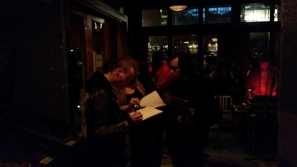 Bim Ditson collecting signatures.
