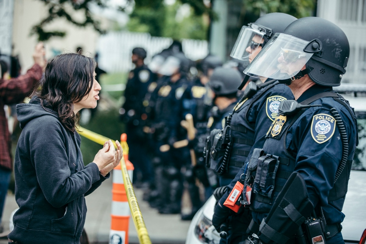 A protester faces off with federal police after a raid of Occupy ICE PDX on  June 28, 2018. (Sam Gehrke)