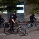 Portland police officers patrol a downtown protest by bicycle on April 20, 2021. (Wesley Lapointe)