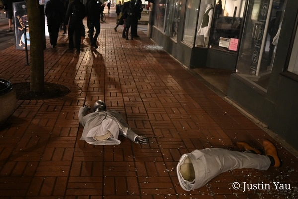 A bridal shop mannequin was dragged from a window into the street on May 25, 2021. (Justin Yau)