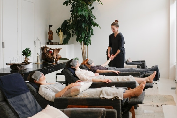 Practitioner Sara Thomas treating patients in Golden Hour's bright warm space. (Steven Xue)