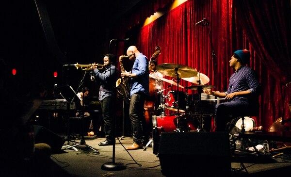 Trumpeter Ambrose Akinmusire playing Jimmy Mak's in 2014. IMAGE: Thomas Teal.