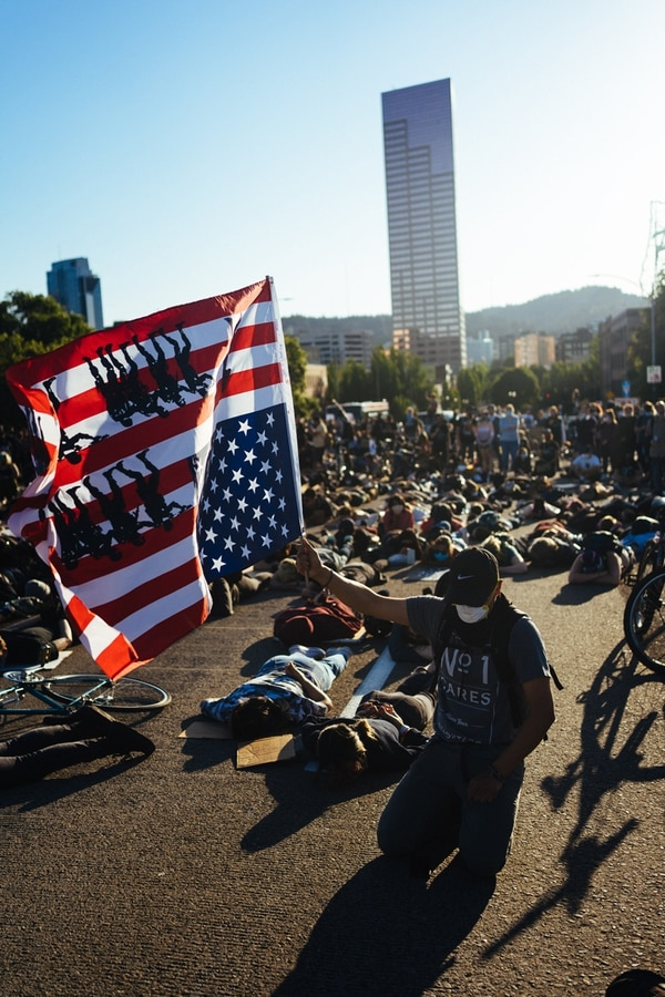 A mass die-in was held on Burnside Bridge at 7:12pm. A moment of silence was observed by the crowd for 8m46s, the time it took for George Floyd to die. (Alex Wittwer) 06012020