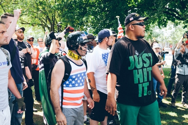 Toese (right) leads chants at a Patriot Prayer rally in August. (Daniel Stindt)