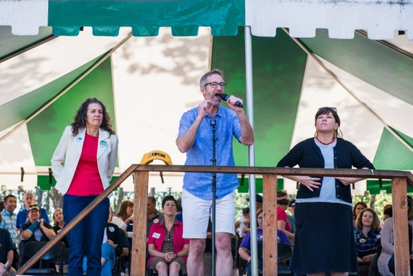 Portland Mayor Ted Wheeler (center) the Northwest Oregon Labor Council AFL-CIO Labor Day picnic at Oaks Park.