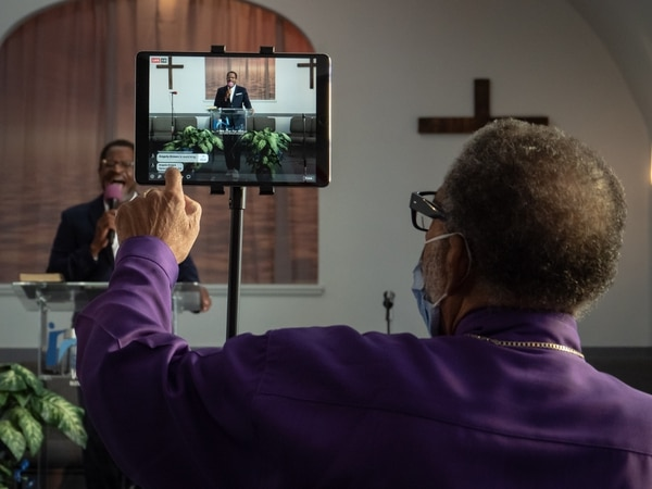 When services start at St. Paul Missionary Baptist Church, few people are in the room—but hundreds are watching the video stream. (Brian Burk)