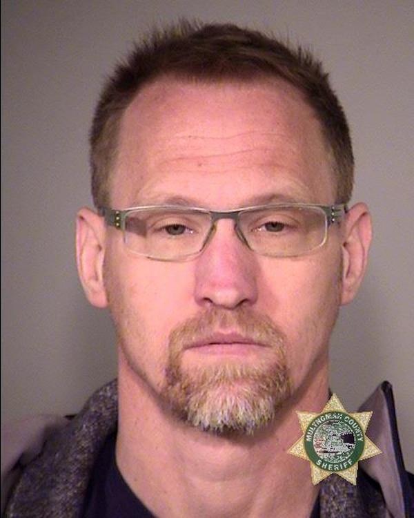 Police arrested Philip Stan Schaefer, 45, on Sunday after he filmed them in a coffee shop. (Portland Police Bureau)
