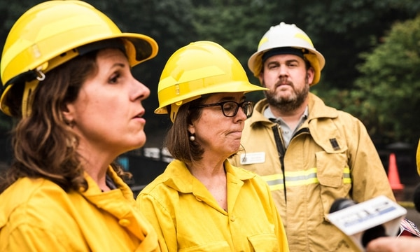 Oregon Gov. Kate Brown speaks to press at the scene of the Eagle Creek Fire on Sept. 6. (Thomas Teal)