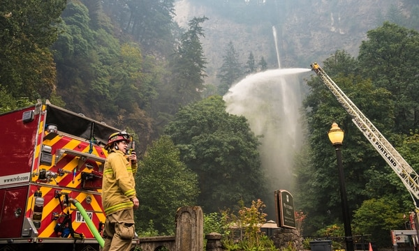 Firefighters spray water around Multnomah Falls on Wednesday, Sept. 6. (Thomas Teal)