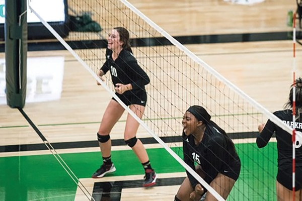 Sinclair Ashley (bottom of photo) played volleyball at Parkrose High School. She graduated in 2018.