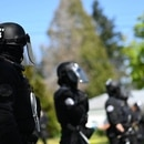 Riot cops at the edge of Lents Park. (Justin Yau)