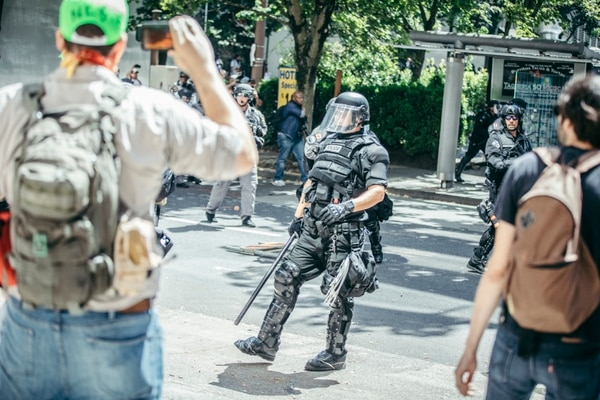 Riot police charged shortly after 2 pm. (Sam Gehrke)