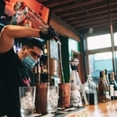 Roy Galván, the owner of Mesa Fresca, prepares a drink for patrons. (Alex Wittwer)