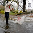 Unclogging storm drains in Portland on Saturday, Oct. 31. (Photo courtesy of KATU.)