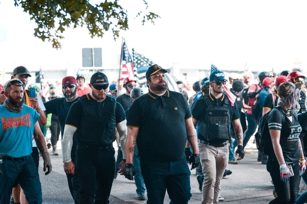 The Aug. 4 showing was one of the largest gatherings of Proud Boys in Portland. The men's fraternity, which wears gold-trimmed polo shirts, has been labeled a hate group by some watchdogs. (Liz Allan)